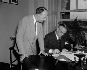 The new associate justice of the Supreme Court, Hugo L. Black, watches as Col. Edward A. Halsey, secretary of the Senate, signs the Senate's confirmation of the Alabama U.S. senator to the nation's highest tribunal; Aug. 17, 1937. (Harris & Ewing, Library of Congress, Prints and Photographs Division)