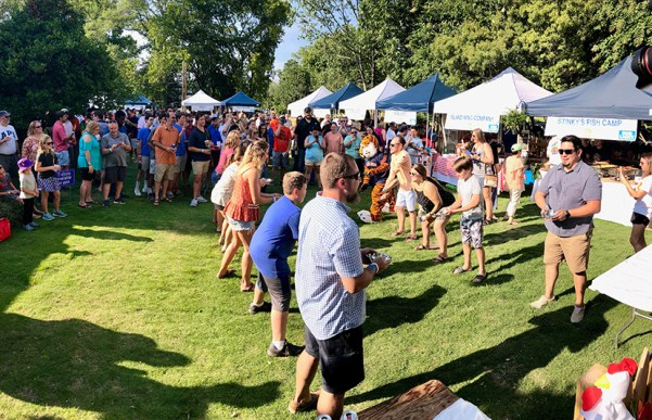 Participants in a wing-tossing contest compete for prizes at a previous Auburn BBQ Fest. (Sarah Hayward)