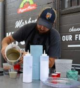 Josh Pigford of Cedar & Sail was the featured Alabama Maker at the Market at Pepper Place recently where he demonstrated how anyone can produce concrete decor using items as common as plastic cups and plates. (Michael Tomberlin / Alabama NewsCenter)