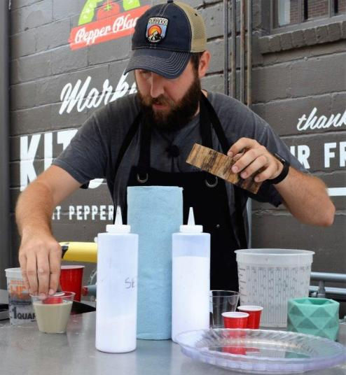 Josh Pigford of Cedar & Sail was the featured Alabama Maker recently at the Market at Pepper Place, where he demonstrated how anyone can produce concrete decor using items as common as plastic cups and plates. (Michael Tomberlin / Alabama NewsCenter)
