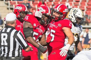 Jacksonville State's Connor Christian (56) and EJ Moss (25) celebrate during last year's victory over Murray State. (Jacksonville State University Athletics)