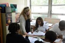 Teacher Morgan Sargent checks out a student's work. (Karim Shamsi-Basha / Alabama NewsCenter)