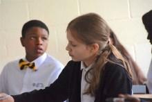 Students do their work in math class. (Karim Shamsi-Basha / Alabama NewsCenter)