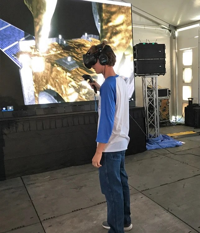 A student checks out an interactive exhibit at the Flight Works Alabama construction kickoff. (Airbus)