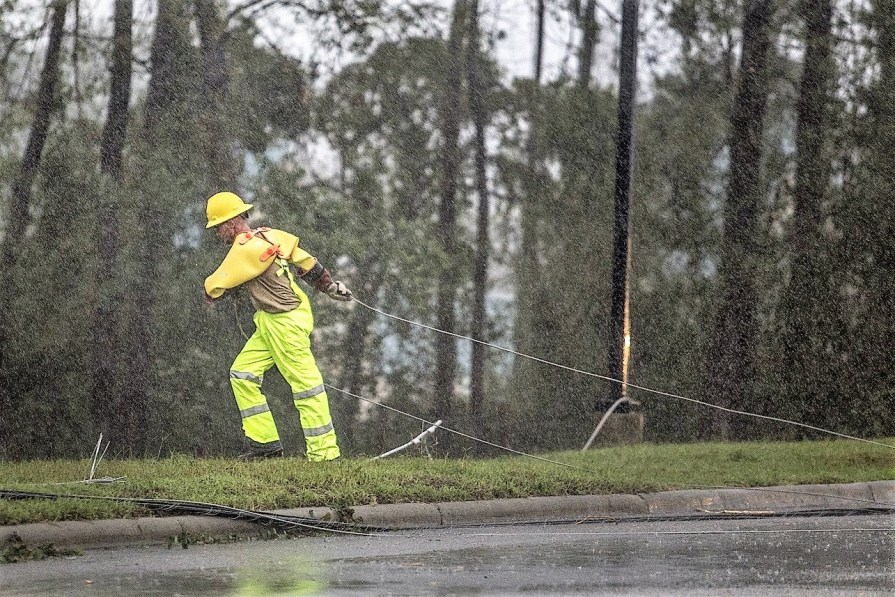 MasTec Inc. employees move a downed power line during Tropical Storm Florence in Hampstead, North Carolina. (Alex Wroblewski/Bloomberg)
