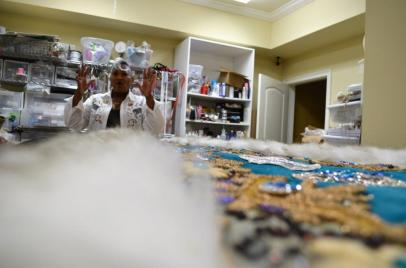 Patricia Richardson has created hand-sewn works of art for Mardi Gras season for several years. (Michael Tomberlin / Alabama NewsCenter)