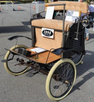 A replica of an 1896 Riker was among the vehicles featured at the National Drive Electric Week at Brookwood Village. (Michael Tomberlin / Alabama NewsCenter)