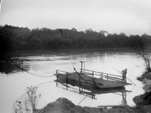 The original ferry between Gee's Bend and Camden, the Wilcox County seat, ran on cables, as shown in this 1939 image by Farm Security Administration photographer Marion Post Wolcott. The ferry was shut down in 1962 by Wilcox County officials as part of the effort to keep African Americans from registering to vote during the civil rights movement. (From Encyclopedia of Alabama, courtesy of The Birmingham News)