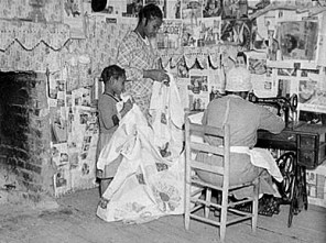 In this 1937 image by Farm Security Administration photographer Arthur Rothstein, Gee's Bend quilter Jorena Pettway sews a quilt as two young girls hold the fabric for her. (From Encyclopedia of Alabama, courtesy of Library of Congress)