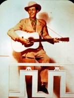 "Hank Williams Sr. played at ""honky tonks,"" bars with rowdy atmospheres frequented by newcomers to the city. The sentiments of Williams's songs appealed to Southerners who had migrated to urban areas. (From Encyclopedia of Alabama, property of the Alabama Music Hall of Fame)"