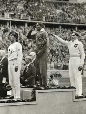 "Naoto Tajima, left, Jesse Owens, center, and Carl Ludwig ""Lutz"" Long, right, won the bronze, gold and silver medals, respectively, in the long jump event at the 1936 Olympics in Berlin, Germany. Long reportedly helped Owens with advice in the event after the American fouled twice during a qualifying round, a courageous gesture of sportsmanship in 1930s Nazi Germany. (From Encyclopedia of Alabama, courtesy of Library of Congress)"