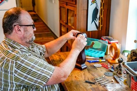 Jason Burnett builds clocks that make people smile. (Mark Sandlin/Alabama NewsCenter)