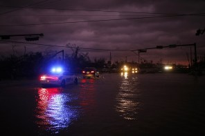 Vehicles drive through floodwaters after Hurricane Michael hit in Panama City, Florida. (Luke Sharrett/Bloomberg)