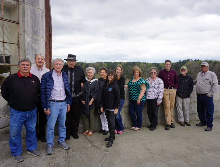 Group photograph taken during the March 2018 visit to the dam. Individuals (left to right): Bill Gardner, Sam Mooney, Joe McDonald, Ken Mooney, Patricia Jones Halladay, Margaret Jones Barnett, Amanda Fleming of Kleinschmidt and Associates, Erin Harney, Gloria Adamson Johnson, Cathie McDonald Stahlkappe, Jeremiah Stager, Bill Tharpe and Denny Winn. (Alabama Power Company Archives and Museum)
