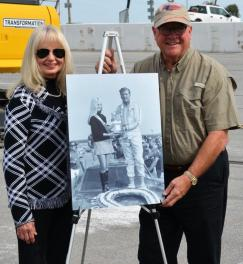 Lana Osborn, left, the first Miss Talladega 500 for the inaugural race in September of 1969, poses with Grant Lynch, chairman of the Talladega Superspeedway. (Michael Tomberlin / Alabama NewsCenter)