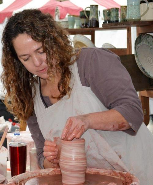 Kerry Kennedy of Fire Horse Pottery is an artist in residence at the Kentuck Art Center and demonstrated her techniques at the Kentuck Festival of the Arts. (Michael Tomberlin / Alabama NewsCenter)