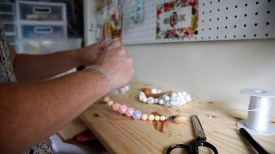 Samantha Echols works on her Indie & Chic line of baby products. (Brittany Faush/Alabama NewsCenter)