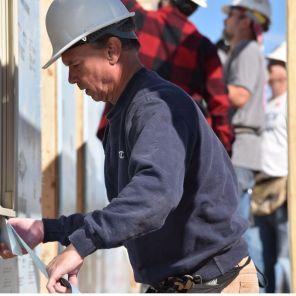 A volunteer diligently works on the Habitat home. (Dennis Washington)