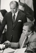 Alabama Gov. George Wallace, seated, and Birmingham Mayor Richard Arrington Jr. in February 1984 discuss a bill authorizing a horse track with legalized gambling in Birmingham. (From Encyclopedia of Alabama, courtesy of the Alabama Department of Archives and History, photograph by James Hatcher)