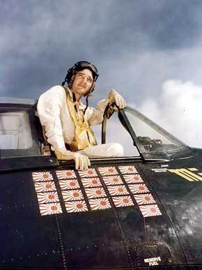 """U.S. Navy Commander David McCampbell poses in his F6F """"Hellcat"""" on board USS Essex (CV-9) in the Pacific theater of World War II in October 1944. (From Encyclopedia of Alabama, courtesy of the U.S. Navy, photograph by Joe Rosenthal)"""