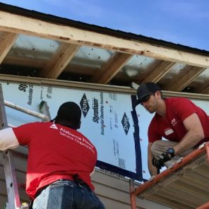 APSO volunteers get this Habitat home ready for the Collins family. (Michael Sznajderman)