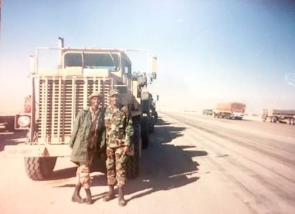 Veteran Edna Felton (left) served in Operation Desert Storm at 18 years old. During the program, attendees watched a slide show with photos from employees' military service. (Edna Felton)