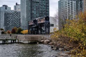 """A gantry that reads """"Long Island"""" is seen from Gantry Plaza State Park in the Long Island City neighborhood in the Queens borough of New York, which will be one of two cities home to the future Amazon.com second headquarters. (Christopher Lee/Bloomberg)"""