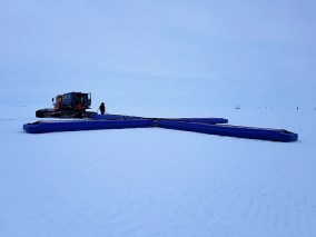 UA engineering researchers built a large antenna, seen in a cross shape on the ice, and a unique radar to image the bottom of an ice stream in Greenland. (University of Alabama)