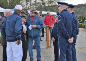 Attendees talk prior to the Wreaths Across America ceremony at the Alabama National Cemetery. (Michael Tomberlin / Alabama NewsCenter)