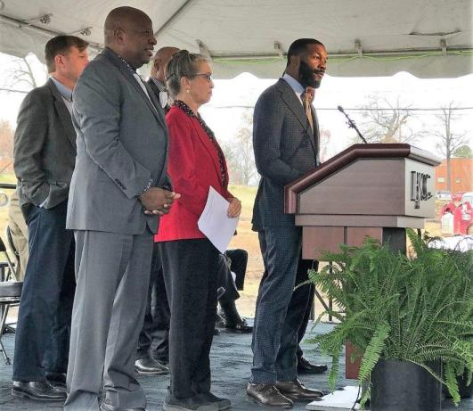 Birmingham Mayor Randall Woodfin in flanked by the Birmingham City Council at the BJCC stadium groundbreaking. (Michael Tomberlin / Alabama NewsCenter)