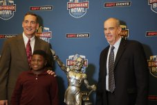 Todd Blackledge, left, and Jeff Rutledge, right, pose with a fan. (Birmingham Bowl)