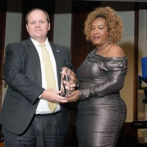 Drew Langloh of the United Way of Central Alabama accepts an award on behalf of the Birmingham Urban League, presented by Bacarra Sanders Mauldin - one of the organization's board members. (Jerome Smedley)