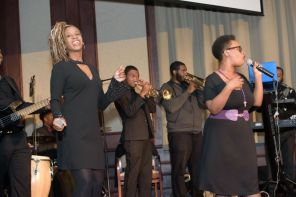 Radio personality Dana Woodruff (left) is joined by band and singers providing entertainment for the evening. (Jerome Smedley)