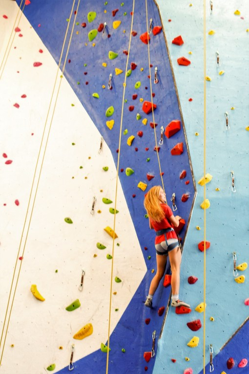 GadRock's Maggie Grizzard enjoys one of the microgym's rope walls. (Justin Averette/Shorelines)