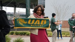 U.S. Rep. Merika Coleman joins in the celebration for the UAB Blazers. (Brittany Faush)