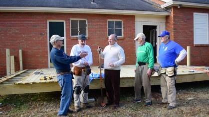 Doug Marshall, middle, chats with volunteers building a deck at the Presbyterian Home for Children. (Karim Shamsi-Basha/Alabama NewsCenter)