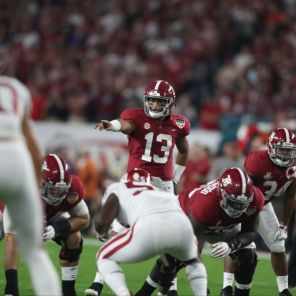 Alabama quarterback Tua Tagovailoa (13) surveys the line. (Kent Gidley)