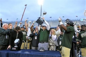 Head coach Bill Clark hoists the Conference USA (C-USA) football championship trophy after the Blazers defeated the Middle Tennessee State University Blue Raiders. (contributed)