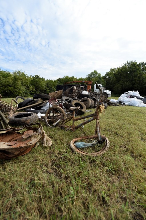 A pile of debris pulled from the water during a Renew Our Rivers cleanup. (file)