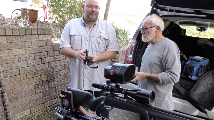 Rick Clark, right, and Jay Busby work on hunting gear for Kidz Outdoors. (Karim Shamsi-Basha / Alabama NewsCenter)