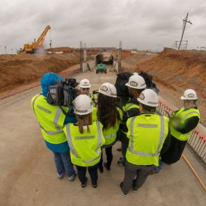 Members of the media talk to legendary NASCAR driver Red Farmer at the site of the new tunnel under construction at Talladega Superspeedway. (Dennis Washington)