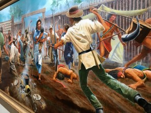 One of Dean Mosher's newest works depicts the bloody battle of Fort Mims. (Dan Bynum/Alabama NewsCenter)