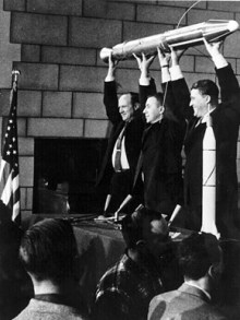 Rocket scientists William Pickering, left, James Van Allen, center, and Wernher von Braun celebrate the launching of Explorer I satellite by a Jupiter-C rocket in January 1958. Explorer I was the first U.S. satellite in Earth orbit and the Jupiter C rocket was developed at Army Ballistic Missile Agency (now Marshall Space Flight Center) in Huntsville. (From Encyclopedia of Alabama, NASA)