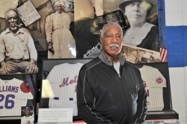 Cleon Jones stands near a display of photos and memorabilia of Africatown's history -- including Jones' thrilling years with the New York Mets. (Karim Shamsi-Basha/Alabama NewsCenter)