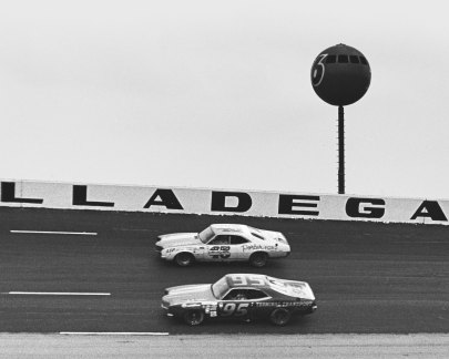 Darrell Waltrip #95 competed in his first ever NASCAR Cup Series event at the Winston 500 at the Alabama International Motor Speedway. He experienced a blown engine and was relegated to 38th place. LeeRoy Yarbrough #45 races on the outside of Waltrip in the Bill Seifert Mercury. (Photo by ISC Images & Archives via Getty Images)