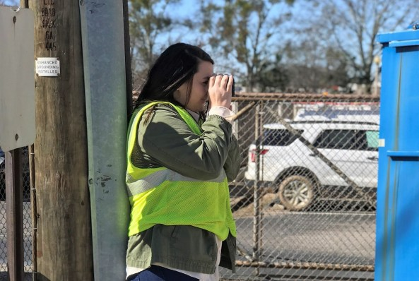 Distribution engineer Jodi Franklin uses a range finder on a job for Alabama Power. (contributed)