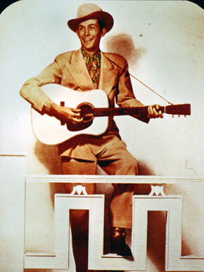 """Hank Williams Sr. played at """"honky tonks,"""" bars with rowdy atmospheres frequented by newcomers to the city. The sentiments of Williams' songs appealed to Southerners who had migrated to urban areas. (From Encyclopedia of Alabama, property of the Alabama Music Hall of Fame)"""