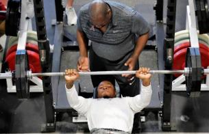 Josh Jacobs participates in the Bench Press at Alabama Pro Day. (Kent Gidley/UA Athletics)