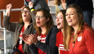 Beth Monson, left, and others root on Monson's daughter Alicia Monson as the Wisconsin junior wins the women's 5,000 meters. (Solomon Crenshaw Jr./Alabama NewsCenter)