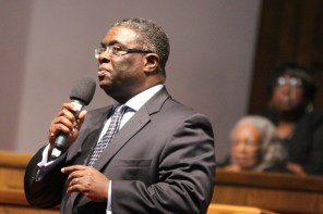 The Rev. Arthur Price, pastor of 16th Street Baptist Church, greets the congressional delegation. (Justin Averette/Alabama NewsCenter)